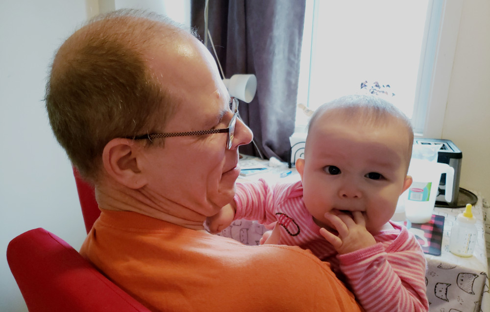 Photo of Papa Zesser holding Baobao the day after she suffered from teething