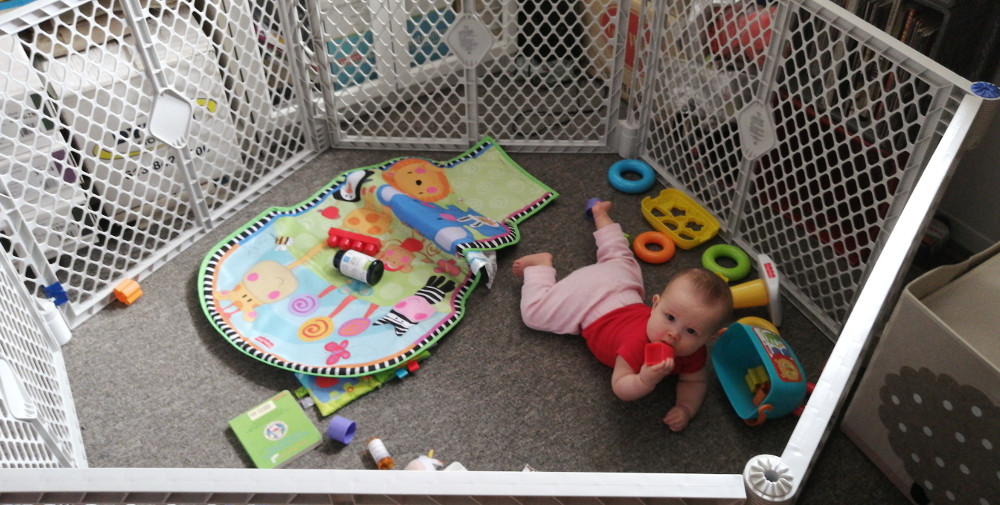 Photo of baby playing in 6-sided playpen.