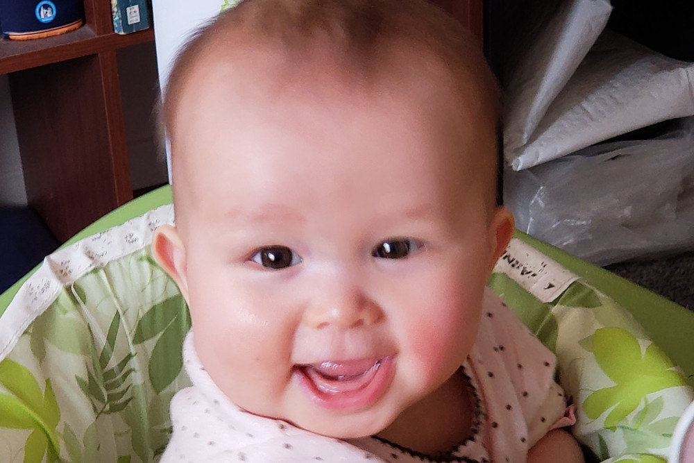 Photo of smiling baby.