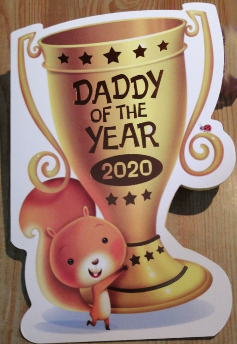 Photo of a Father's Day card cover reading Daddy of the Year 2020