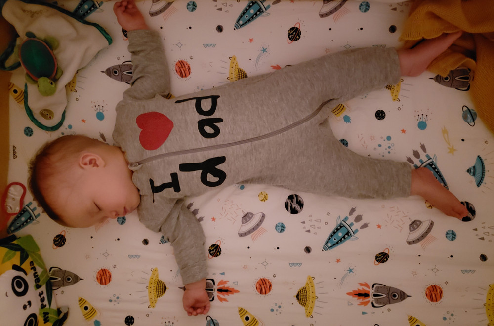 """Photo of Bay Baobao asleep with onesy reading 'I Heart dad"""" on the night of August 21, 2020."""
