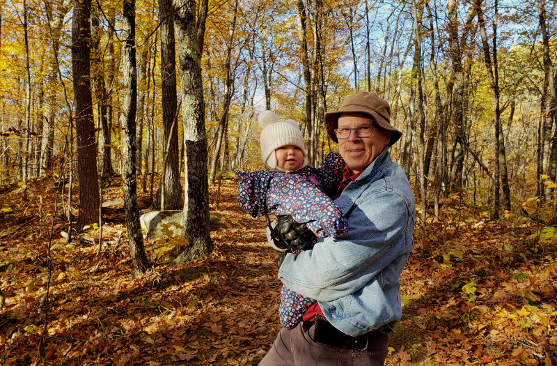 Photo of Papa Zesser holding baby Baobao while hiking through Parc Mont-Morisset